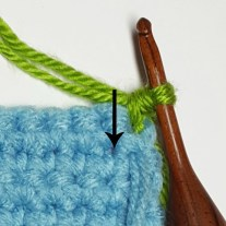 Showing where to place spike stitch, one row down.