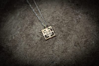 TPB1 - Small brass Bayon on silver chain