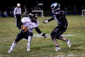 Photo by Hannah Brown/Special from The State Journal Boyle County's Evan Tarter attempts to avoid a hit from Western Hills' Trevor James during the game at WHHS Friday night.