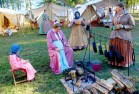 Reenactors play their parts in the living history village.
