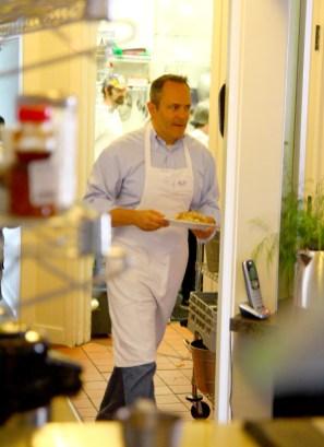 Ben Kleppinger/ben.kleppinger@amnews.com Gov. Matt Bevin brings an order out of the kitchen at Grace Café.