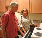 Kendra Peek/kendra.peek@amnews.com Jim and Mary Lester look around in an apartment at the Goodall Apartments, officially opened on Friday.