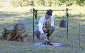 Kendra Peek/kendra.peek@amnews.com Craig Bryant from Tampa, Florida, stokes the fire in camp. Bryant began reenacting about three years ago.