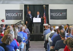Kendra Peek/kendra.peek@amnews.com H Luke Durudogan, president of Meggitt Aircraft Braking Systems, and Gov. Matt Bevin speak to employees and officials at the $9.3 million expansion project.