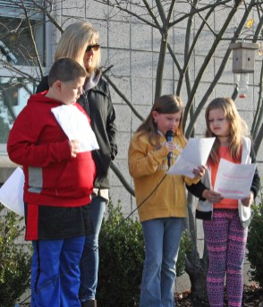 Kendra Peek/kendra.peek@amnews.com Junction City students Charlie Edwards, Kesley Rector and Andrea Godby speak at a morning Veteran's Day Celebration at Junction City Elementary School, while principal Pam Strunk stands nearby.