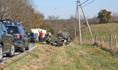 Kendra Peek/kendra.peek@amnews.com Boyle County Firefighters and Sheriff's Deputies clean up the scene following a single-vehicle accident on Ky. 52.