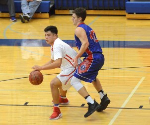 LINCOLN'S Carlos Nunez powers his way inside against Montgomery's Hayden Chism during the Clash of Titans Tournament at Mercer County. Photo by Nancy Leedy