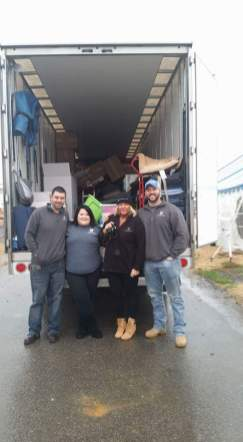 Two Men and a Truck, second from left is Kayla Shannon Dover in Gatlinburg