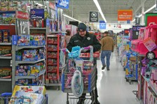 Kendra Peek/kendra.peek@amnews.com Danville Firefighter Michael Riley checks his list while shopping for toys for the Danville Fire Department Toy Drive.