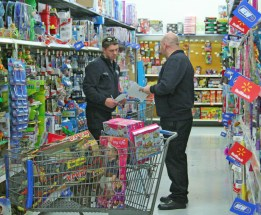 Kendra Peek/kendra.peek@amnews.com Danville Firefighter Justin McBride and Lt. Patrick Denham compare shopping lists while shopping for the Danville Toy Drive.
