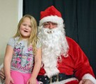 Kendra Peek/kendra.peek@amnews.com Crystal Coffey with Santa, Bruce Coffman