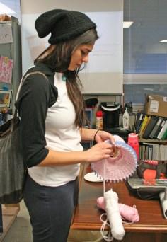 Kendra Peek/kendra.peek@amnews.com Ariel Dishon uses a loom to crochet a hat during Shelly Stinnet's class at Danville High School.