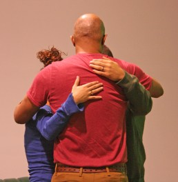 Kendra Peek/kendra.peek@amnews.com Pastor James Hunn, center, prays with Toni Ward, left, and her brother Rob Rodriguez, right, during the Hope Network meeting on Tuesday. Rodriguez was there to share his story of addiction and recovery, after graduating from a rehab center.