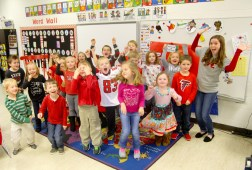 Photos by Ben Kleppinger/ben.kleppinger@amnews.com | Kindergartners in Sarah Shadburne's class cheer for the Falcons while wearing their red clothes Thursday afternoon.