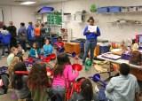 Kendra Peek/kendra.peek@amnews.com Destiny Carter teaches students to play the trombone at Hogsett Elementary School.