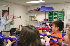 Kendra Peek/kendra.peek@amnews.com Conner Kinman teaches students to play at Hogsett Elementary School.