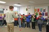 Kendra Peek/kendra.peek@amnews.com Conner Kinman teaches students to play trumpet at Hogsett Elementary School.