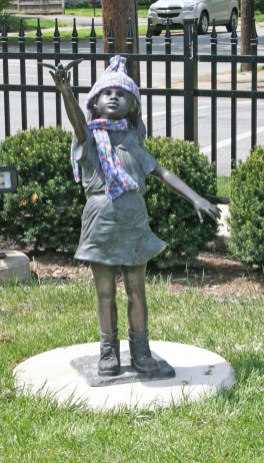 Kendra Peek/kendra.peek@amnews.com A statue at the Boyle County Public Library wears a scarf as part of the All Wrapped Up project through the Danville High School art classes.