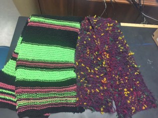 Photo submitted Two scarves sent to the Danville High School for the All Wrapped Up project, to wrap Danville's trees in yarn. The scarves were sent from Liz Morrison of Ohio and are just two of many that have come from all over the country, said teacher Shelly Stinnett.