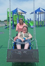 Kendra Peek/kendra.peek@amnews.com Mercer County resident Samantha Travillian pushes her friend and former classmate Shelbi Hopper on a swing made to for wheelchairs.