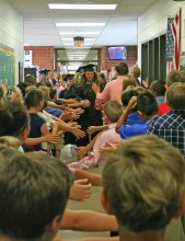 Kendra Peek/kendra.peek@amnews.com Senior Jacob Padgett leads the Boyle County HIgh School grad walk through Woodlawn Elementary. The seniors were met with cheers at each of the district's elementary schools on Friday.