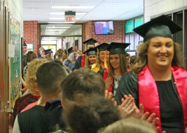 Kendra Peek/kendra.peek@amnews.com Boyle County HIgh School graduating seniors were met with cheers at each of the district's elementary schools on Friday. Seniors were high-fived by students at Woodlawn Elementary School.