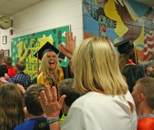 Kendra Peek/kendra.peek@amnews.com Woodlawn teacher Jennifer Pierson high-fives Elizabeth Lyons, a former student, as Lyons completed the graduate walk Friday at Woodlawn Elementary School.