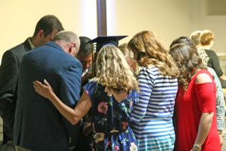Kendra Peek/kendra.peek@amnews.com Teachers at DCA pray over Sarah Elizabeth Bridges after she received her diploma at the Danville Christian Academy Graduation 2017.
