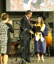 Kendra Peek/kendra.peek@amnews.com Madison Elizabeth Carnes accepts her diploma from Board Chairman Fred Sizemore.