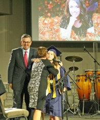 Kendra Peek/kendra.peek@amnews.com Madison Elizabeth Carnes hugs Headmaster Debbie Lucas after accepting her diploma from Board Chairman Fred Sizemore at the Danville Christian Academy graduation on Saturday.