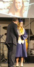 Kendra Peek/kendra.peek@amnews.com Jenny Beth Cox accepts her diploma from Board Chairman Fred Sizemore at the Danville Christian Academy graduation on Saturday.