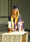 Kendra Peek/kendra.peek@amnews.com Danville Christian Academy Graduate Jewelia Marie Metz lights a candle during the commencement ceremony on Saturday.