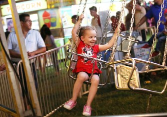 Kaylynn Johnson, 3, of Stanford enjoys a kids ride at the fair.