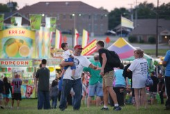 Fairgoers enjoy perfect weather just before sunset Wednesday.
