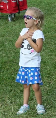 Kendra Peek/kendra.peek@amnews.com Mackenzie Richardson, 4, watches the swings in awe Friday night at the Boyle County Fair.