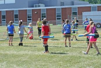 Kendra Peek/kendra.peek@amnews.com Third and fourth graders play human foosball at Black and Gold Academy.