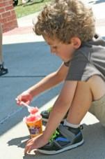 Kendra Peek/kendra.peek@amnews.com Charlie Schneider eats Kona Ice outside the Boyle County High School at Black and Gold Academy.