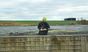 Darrell Simmons, with Vittitow Basement Walls, sets a brace in place to secure the forms where concrete will be poured.