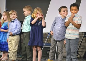 """The first class to give a presentation Thursday night was the youngest students who recited the definition of an """"infinitive,"""" from their grammar class. From left, Maya Henson, Ethan Voshell, Benton Brown, Emma Faulkner, Robin Harris and Jace Montgomery stand on stage."""