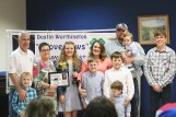 Photos contributed Dennis and Dena Worthington and grandson Bryson Ward presenting plaque to Mercer County Winner Jorga Sanford and her family.