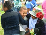 Lamireyan Wilhite is hugged by friends after winning the final Kidtucky Derby at Jennie Rogers Elementary School Friday afternoon.