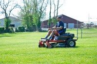 Photos submitted John Raines mows at Cowan Park on May 1.