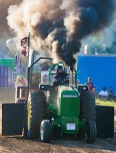 "Melvin Abbott of Crestwood drives the ""Hillbilly Rocket."" Abbott placed fourth in the hot farm tractor division."