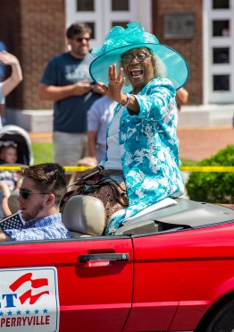 Perryville Mayor Anne Sleet waves to a friend in the crowd.