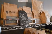 The popular bagged version of Dry Stack Coffee lines the shelves of Plank on Main, provided by Aaron and Leigh Ranson.