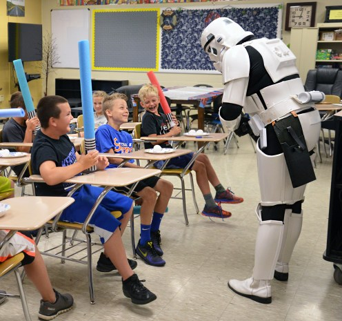 At the Black and Gold Academy Wednesday morning members of the Jedi Academy are greeted by an official Storm Trooper character. (Photo by Robin Hart)