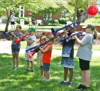 Kendra Peek/kendra.peek@amnews.com Kids play trombones and trumpets at the Creation Station at the Great American Brass Band Festival.