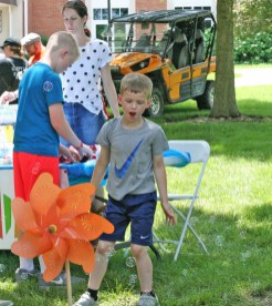 Kendra Peek/kendra.peek@amnews.com Joel Sergent, 6, chases bubbles at the Creation Station during the Great American Brass Band Festival.