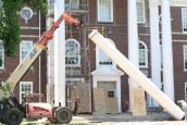 Kendra Peek/kendra.peek@amnews.com The second column is lifted into a vertical position to be placed at Toliver Elementary School.