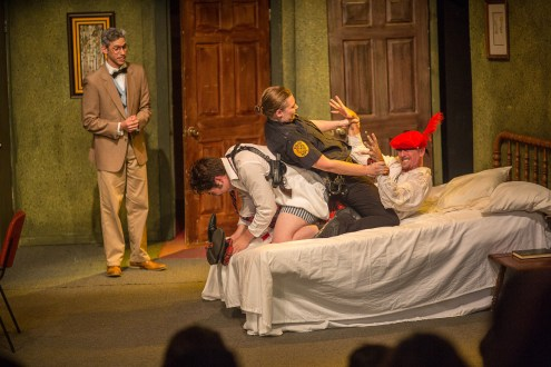 """Ben Kleppinger/ben.kleppinger@amnews.com """"Unnecessary Farce"""" is filled with physical comedy, such as this fight on a bed. From left are Mayor Meekly (Dalton Graves), Eric Sheridan (Giancarlo Herrera), Billie Dwyer (Andi Johnson) and Todd (Daniel Hall Kuhn)."""